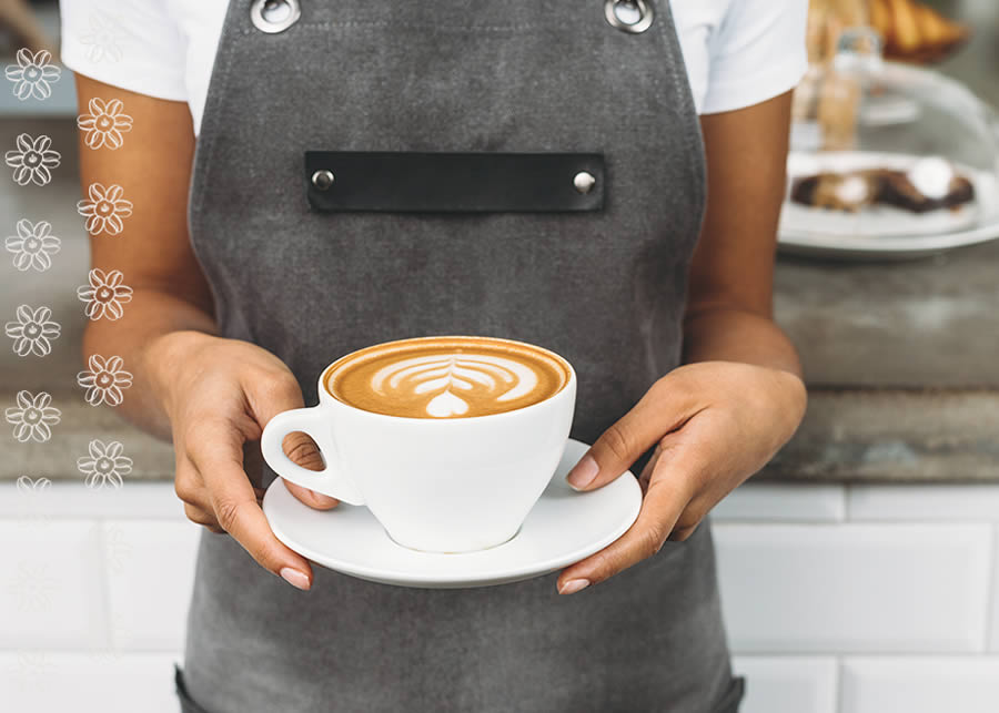 barista holding a coffee cup.