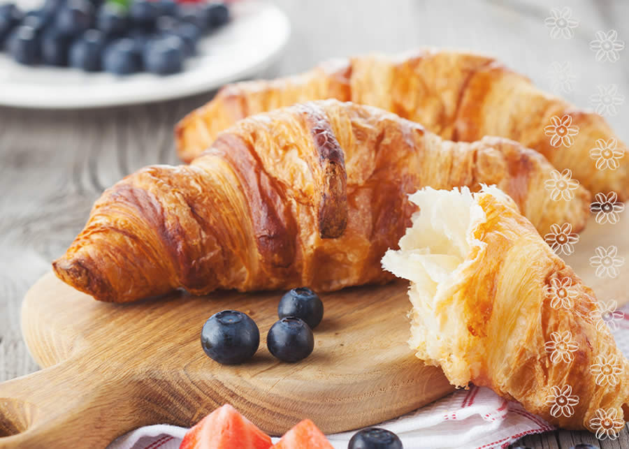 fresh croissant with fruit on a cutting board.