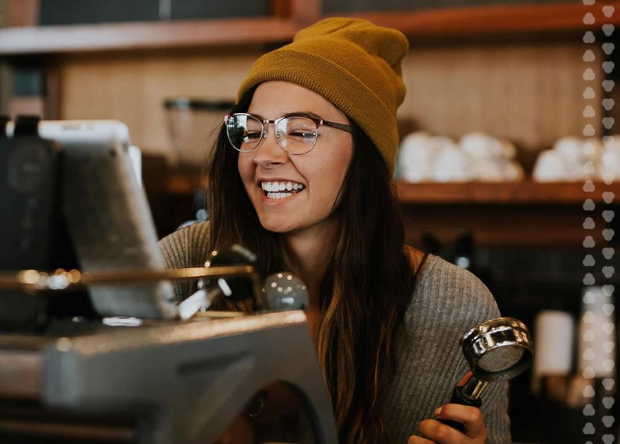 barista ringing up an order at McGavock's