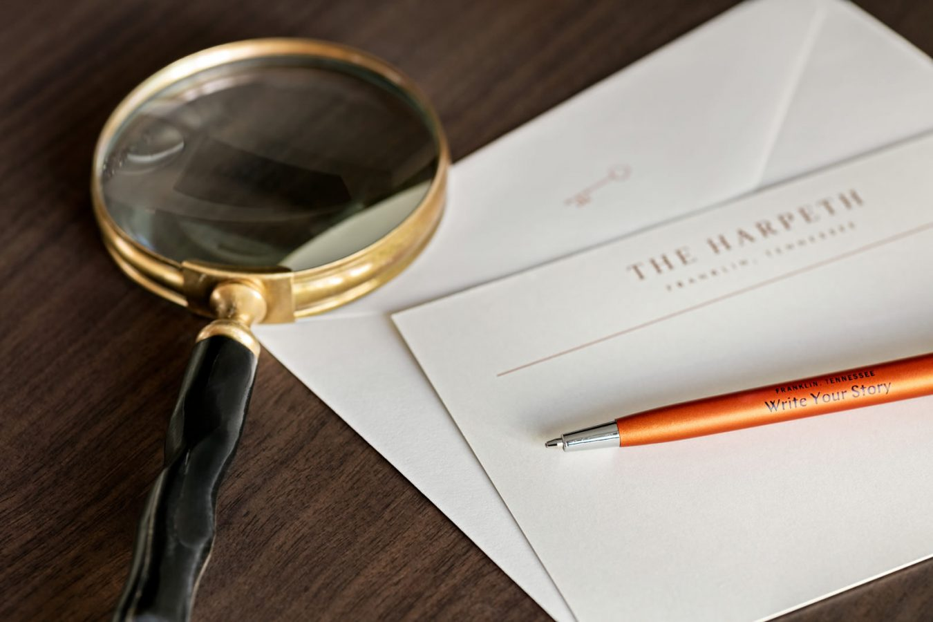 Magnifying glass, pen, and stationery, Downtown Franklin Hotel, The Harpeth Hotel